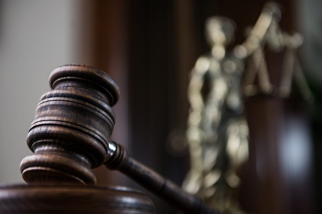 picture of gavel and lady justice in the background